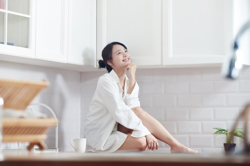 Woman sitting on counter