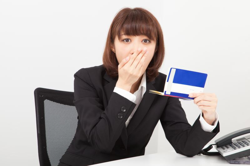 Woman looking at her checkbook in shock