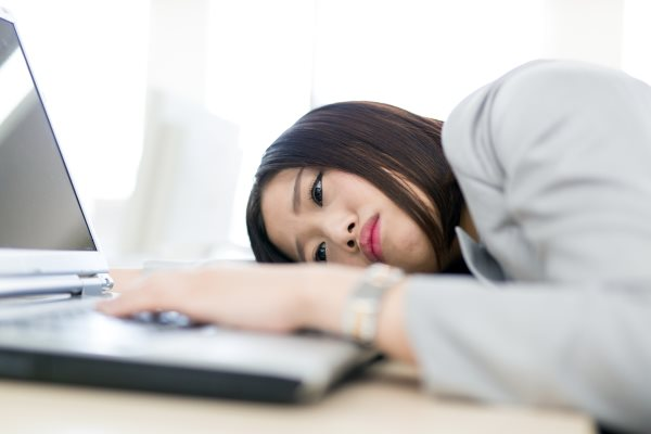 Woman depressed at computer