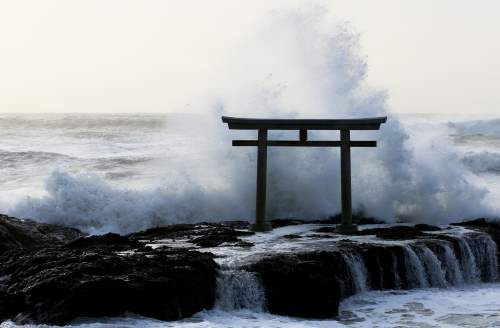 A torii battered by a storm.