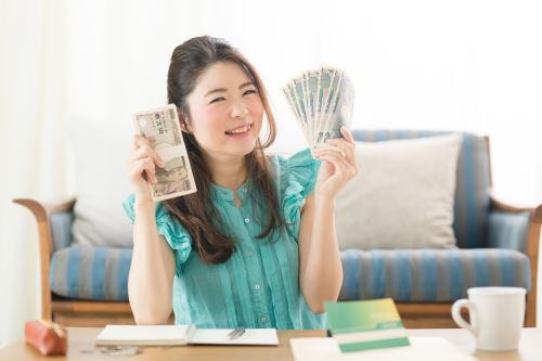 A woman holding her well-gained money.
