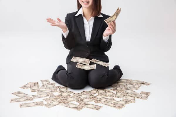 A woman holding money