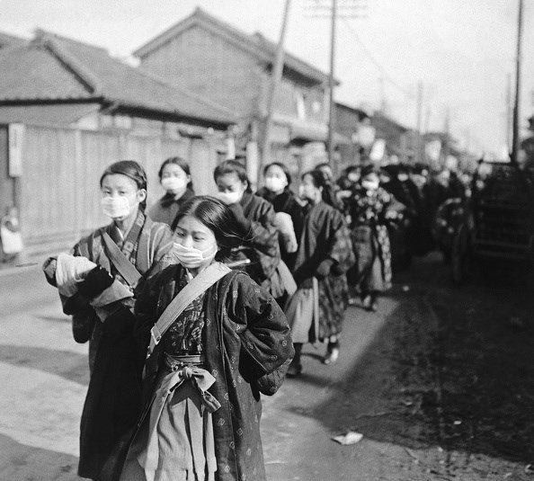 Japanese school girls wear protective masks to guard against the influenza outbreak.