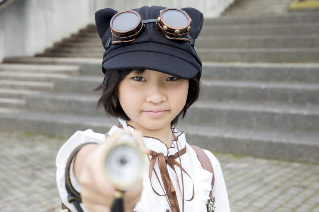 Girl with toy gun
