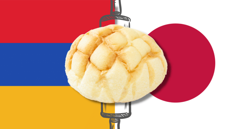 A melonpan atop the flags of Armenia and Japan.